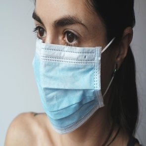 unemployment benefits due to coronavirus syracuse ny woman wearing face mask