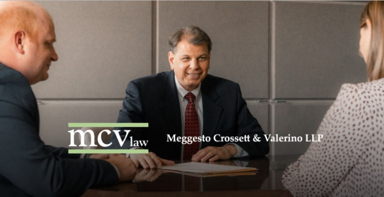 landlord lawyer near syracuse ny image of attorney meeting with client mcv law logo meggesto crossett and valerino llp
